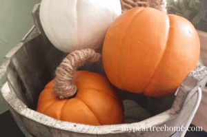 These mini pumpkins were made from faux apples!