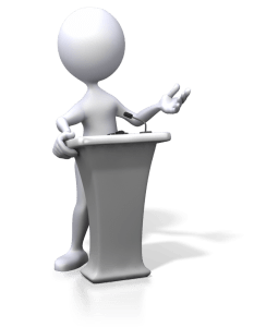 figure giving speech at podium