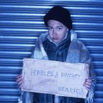 homeless hungry child with sign