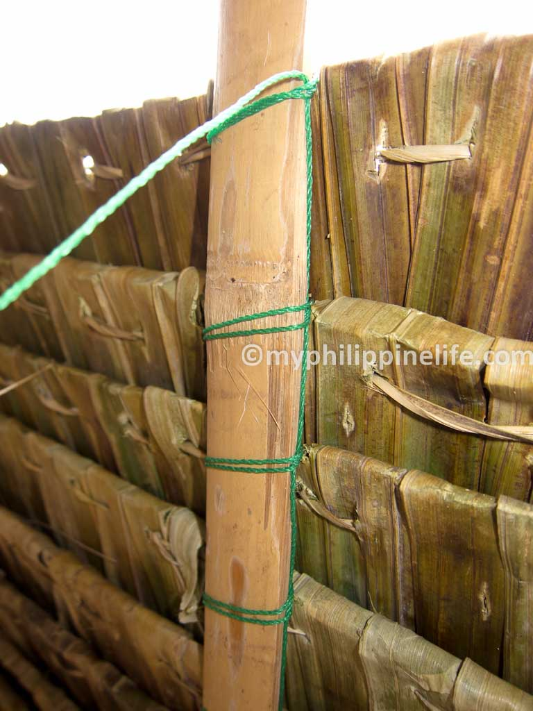 The nipa panels are made by bending leaves of the nipa palm around a thin bamboo rib the rib is kept in place with a stitching of bamboo fibers or a vine