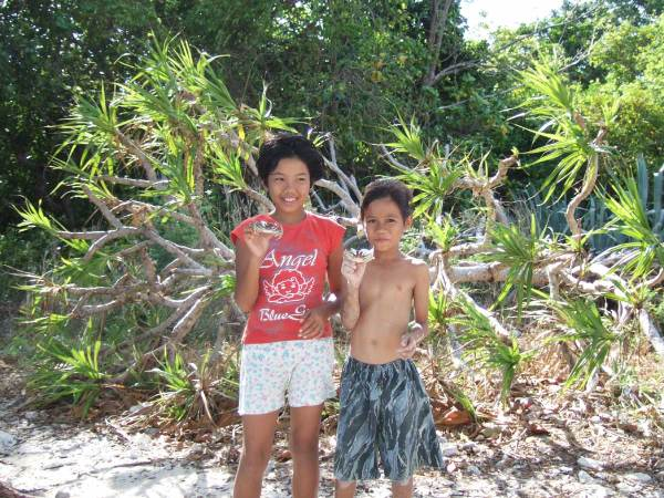 We say goodbye to our helpers.  Nogas Island, Antique Province, Philippines