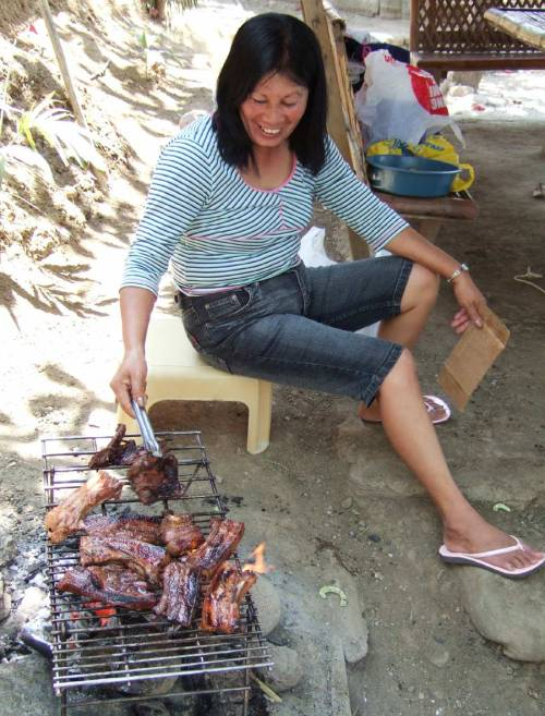 Eli's cousin Ann expertly BBQs pork belly - Sira-an Hot Springs Resort