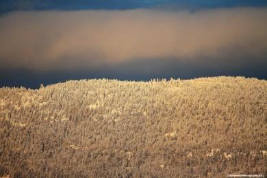 Sun shining on mountains behind Naramata