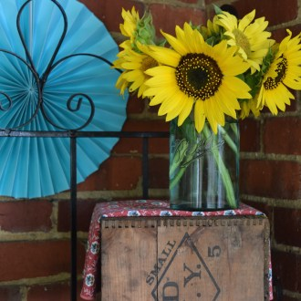 RUSTIC WITH A PUNCH OF COLOR:  Sunflowers on the porch