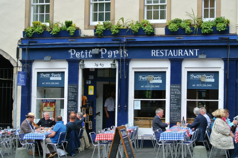People dining in the front of Petit Paris Restaurant in Grassmarket in Edinburgh.