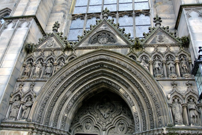 Intricate stone carvings on the facade of St. Giles Cathedral in Edinburgh, Scotland.