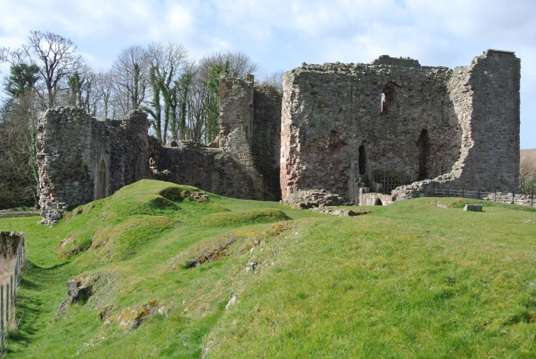 Hailes Castle ruin and grass covered hills.