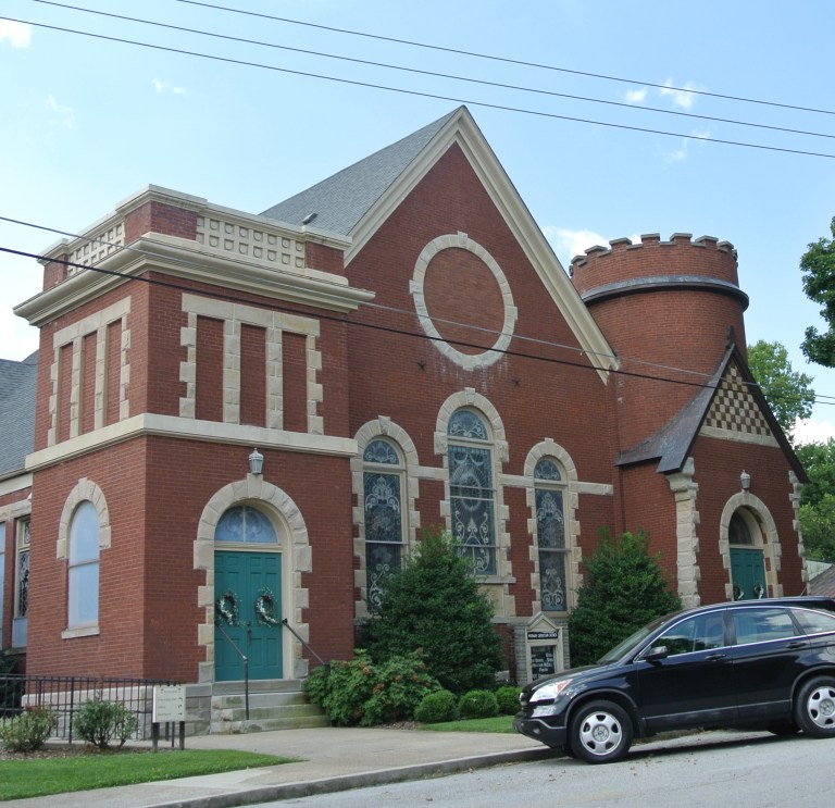 An old red brick church with lots of ornamentation.