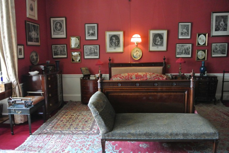 A red bedroom at Lauriston Castle.