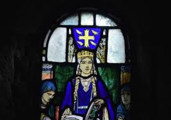 A stained glass window of St. Margaret.