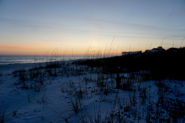 White sandy beach at sunset.
