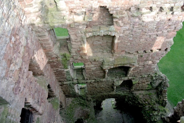 Multiple exposed floors and fireplaces at Tantallon Castle in Scotland.