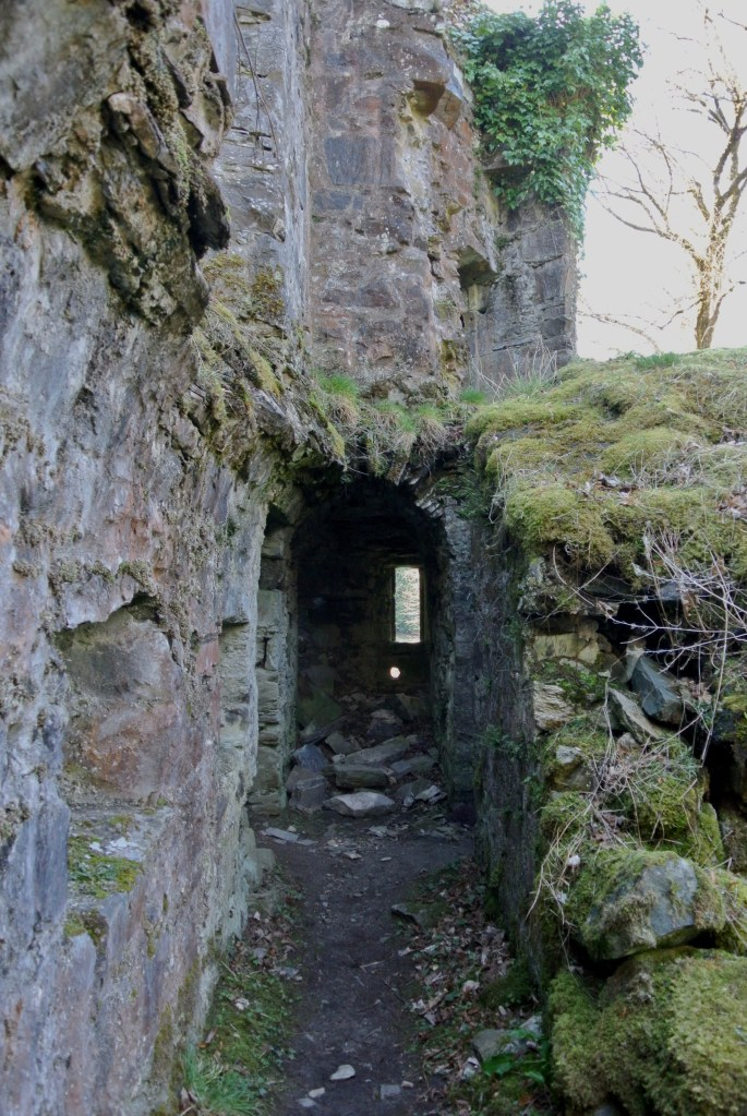 An exposed and crumbling corridor at Finlarig Castle.