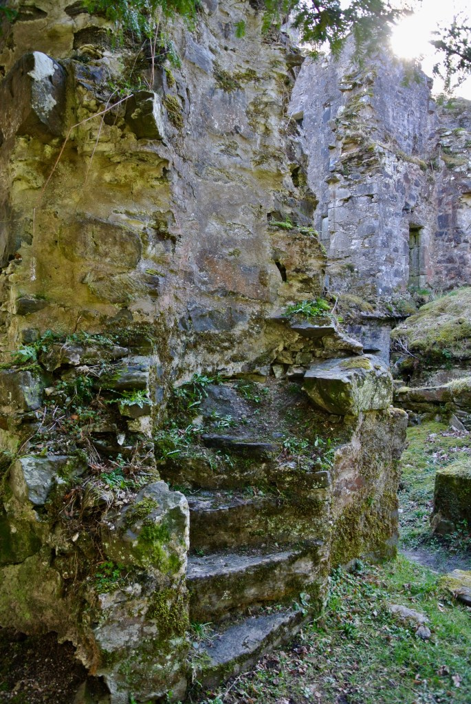 An exposed weathered staircase at Finlarig Castle.