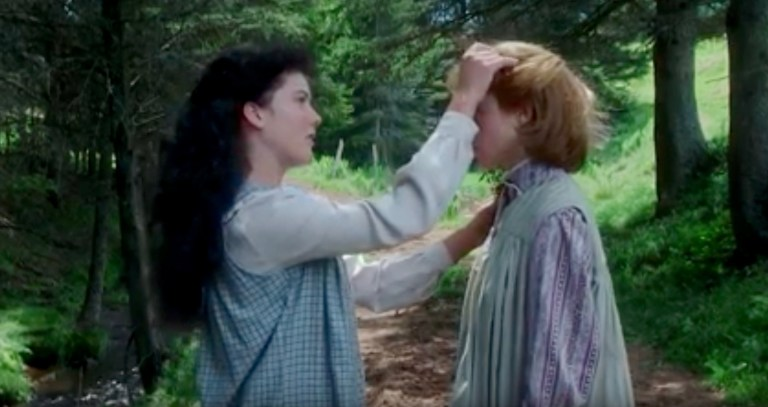 From Anne of Green Gables, Diana Barry tucking a spring of Queen Anne's Lace into Anne's hair.