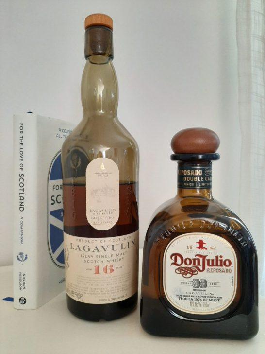 A bottle of 16 year old Lagavulin next to a bottle of a Don Julio special edition.