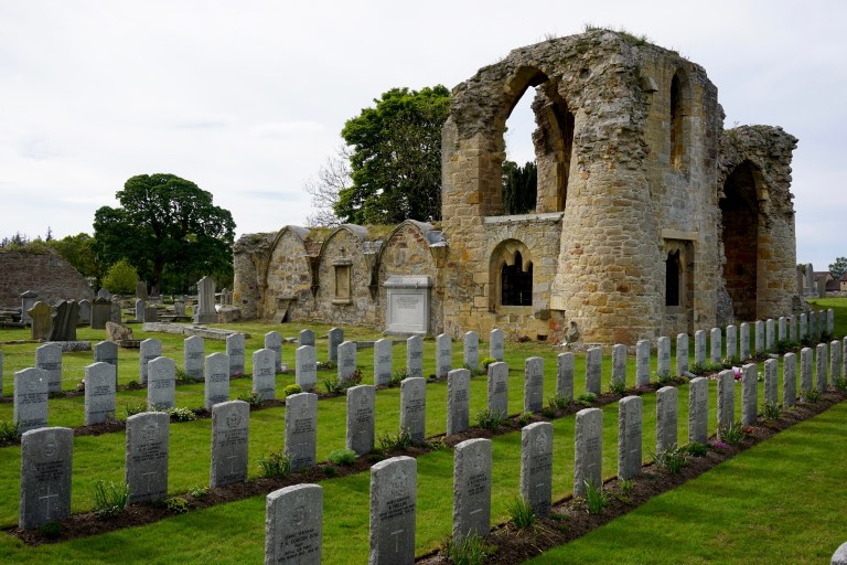 Kinloss Abbey ruins and rows of World War II gravestones.