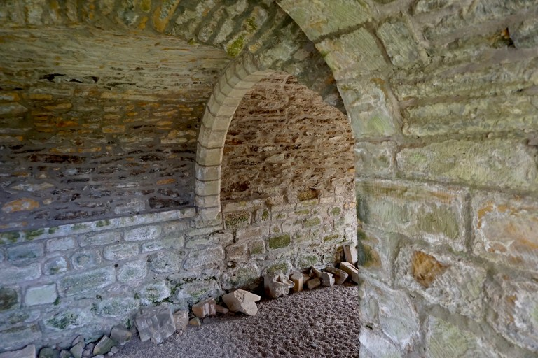 An arched door frame inside Kinloss Abbey.