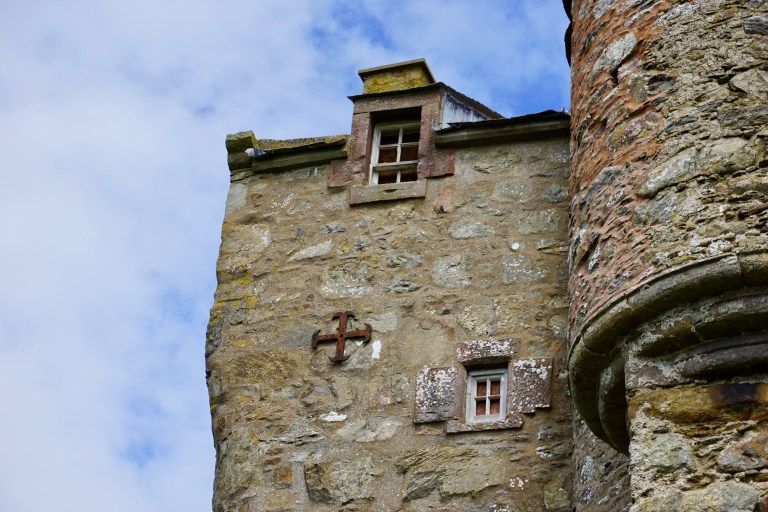 A cross on the outside of Inchdrewer Castle in Scotland.