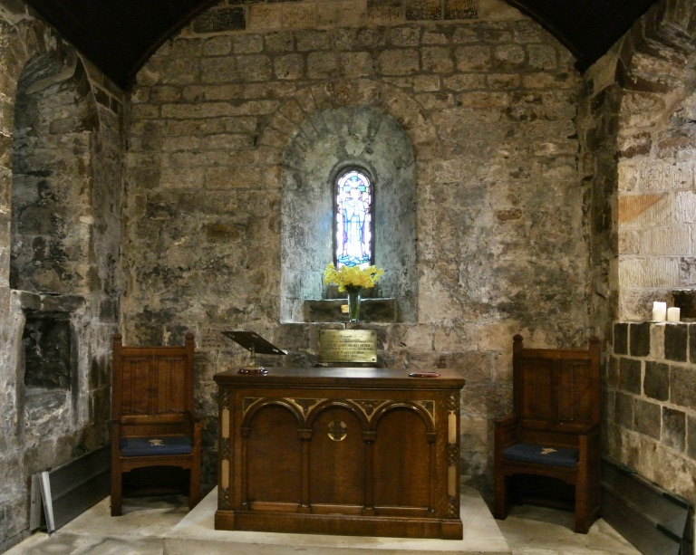 A table and two chairs inside St. Fillan's Church.