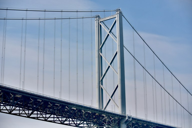 A close up view of the Forth Road Bridge in Scotland.