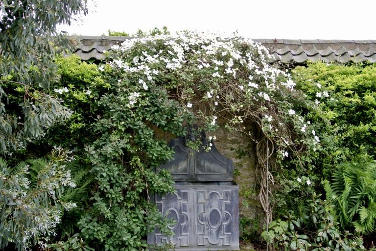 A decorative gray garden door.
