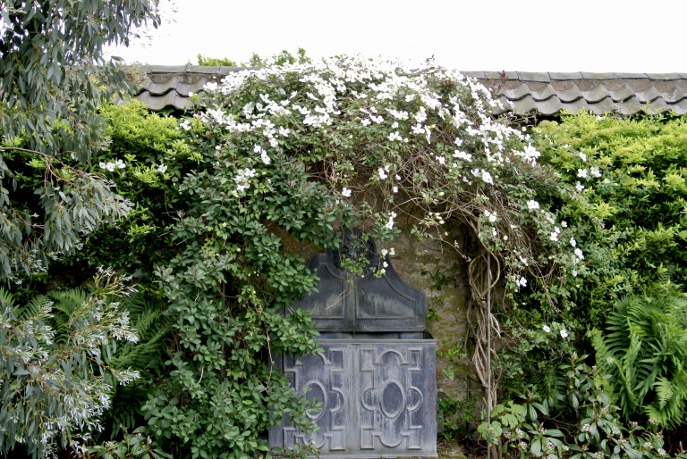 A decorative gray garden door.