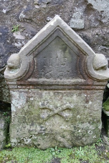 An old, worn gravestone.