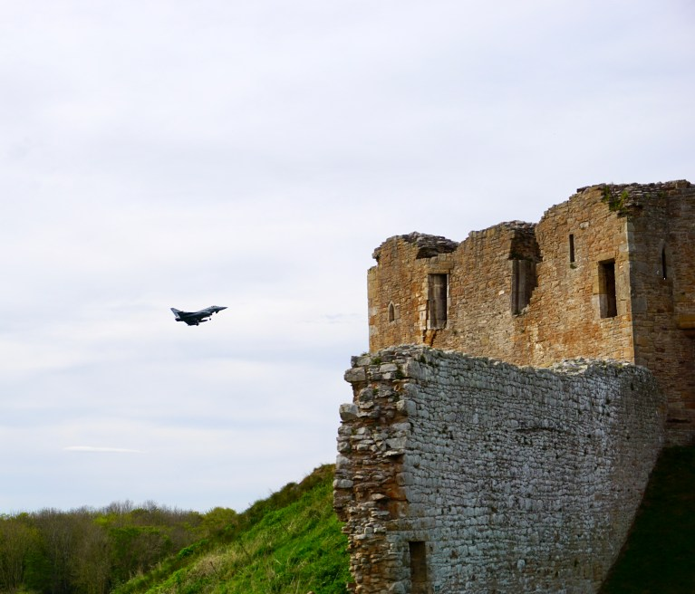 A RAF fighter jet flying past Duffus Castle.