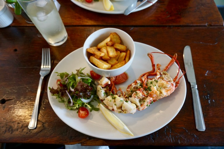 Lobster, french fries, and salad.