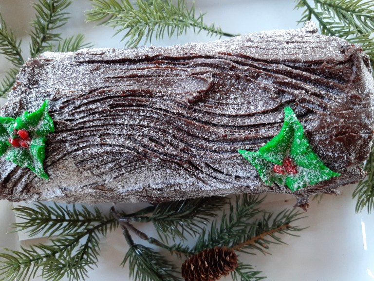 a chocolate frosted Yule log cake