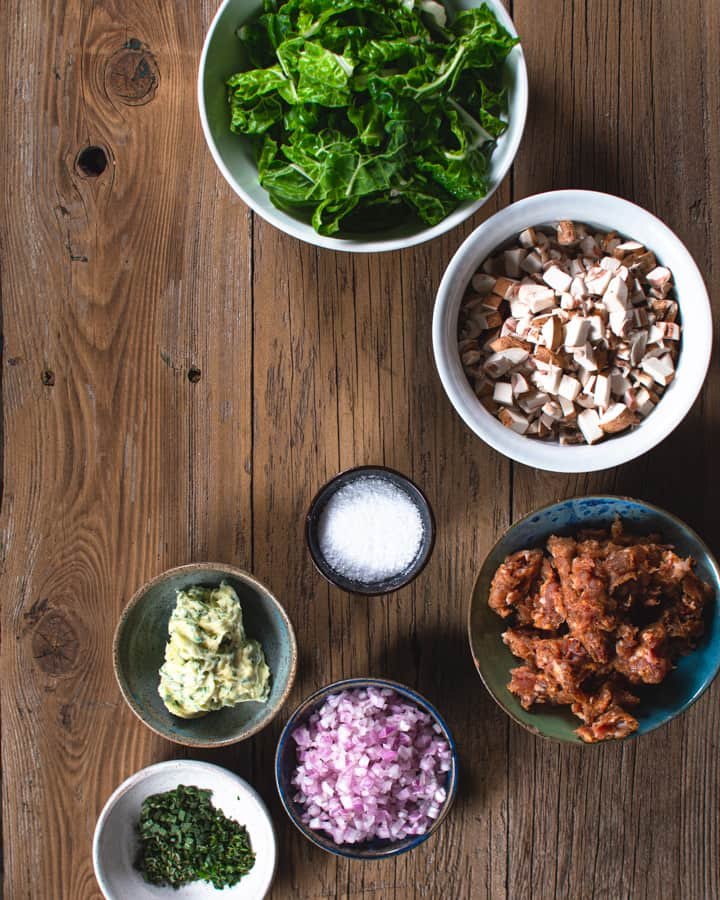 swiss chard, mushrooms, sausage, shallots, salt, butter and parsley in separate bowls