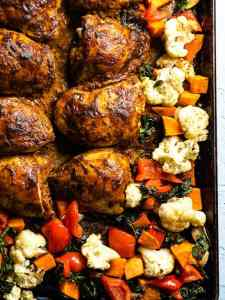 Sheet pan curried chicken and vegetables cooked on a tray