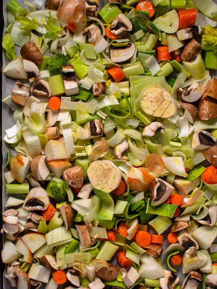 chopped vegetables on tray before roasting