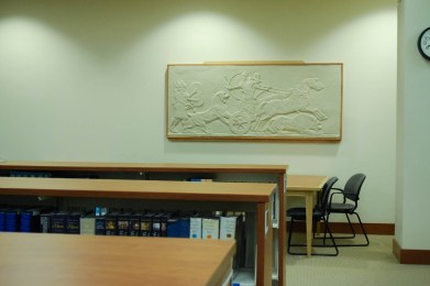 A framed relief in the lower-level of the library