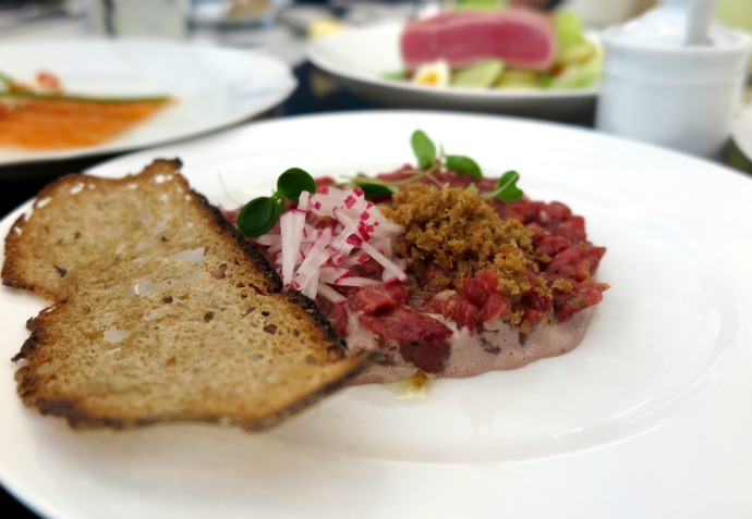 Steak Tartare - hand cut beef, black olives, cornichon and basil.