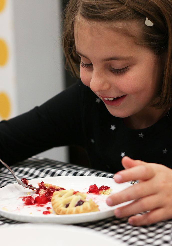 Girl eating Apple and Blackberry tart - mypoppet.com.au