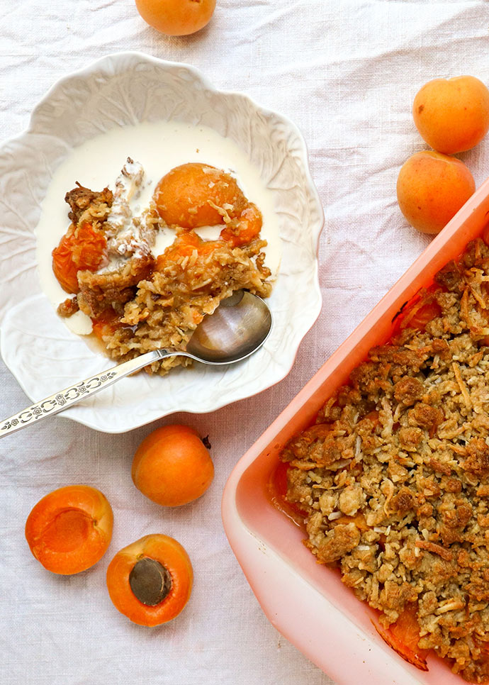 apricot crumble in a bowl with cream
