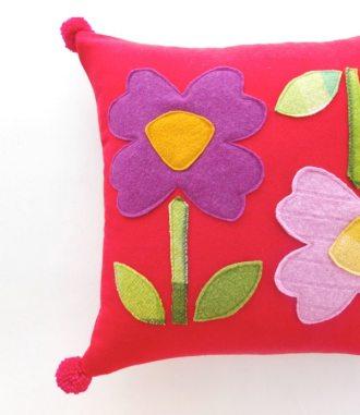 Giant flower applique cushion finished with pom pom