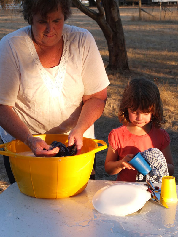 campsite washing dishes tub