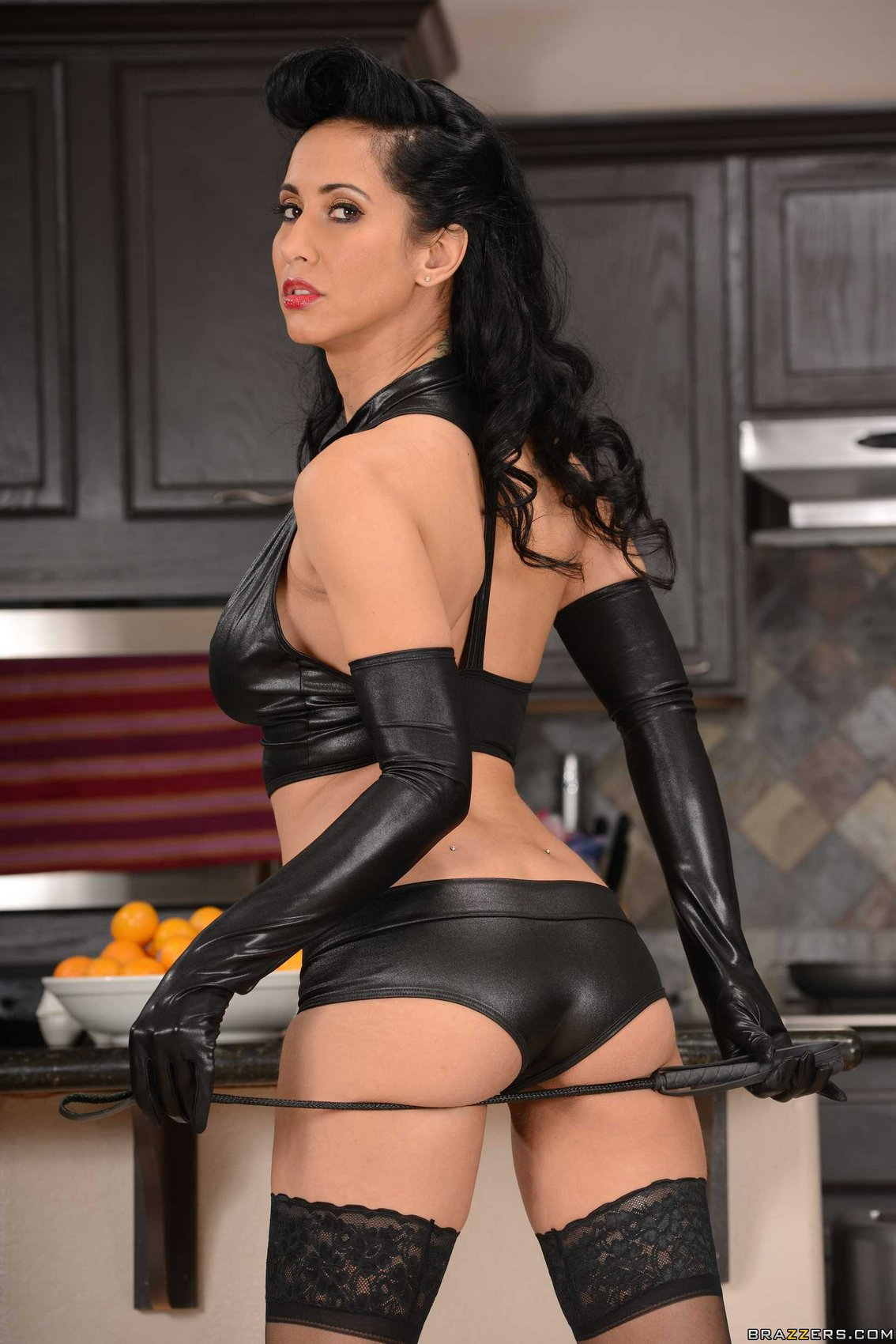 Sexy mistress Isis Love posing in the kitchen  My