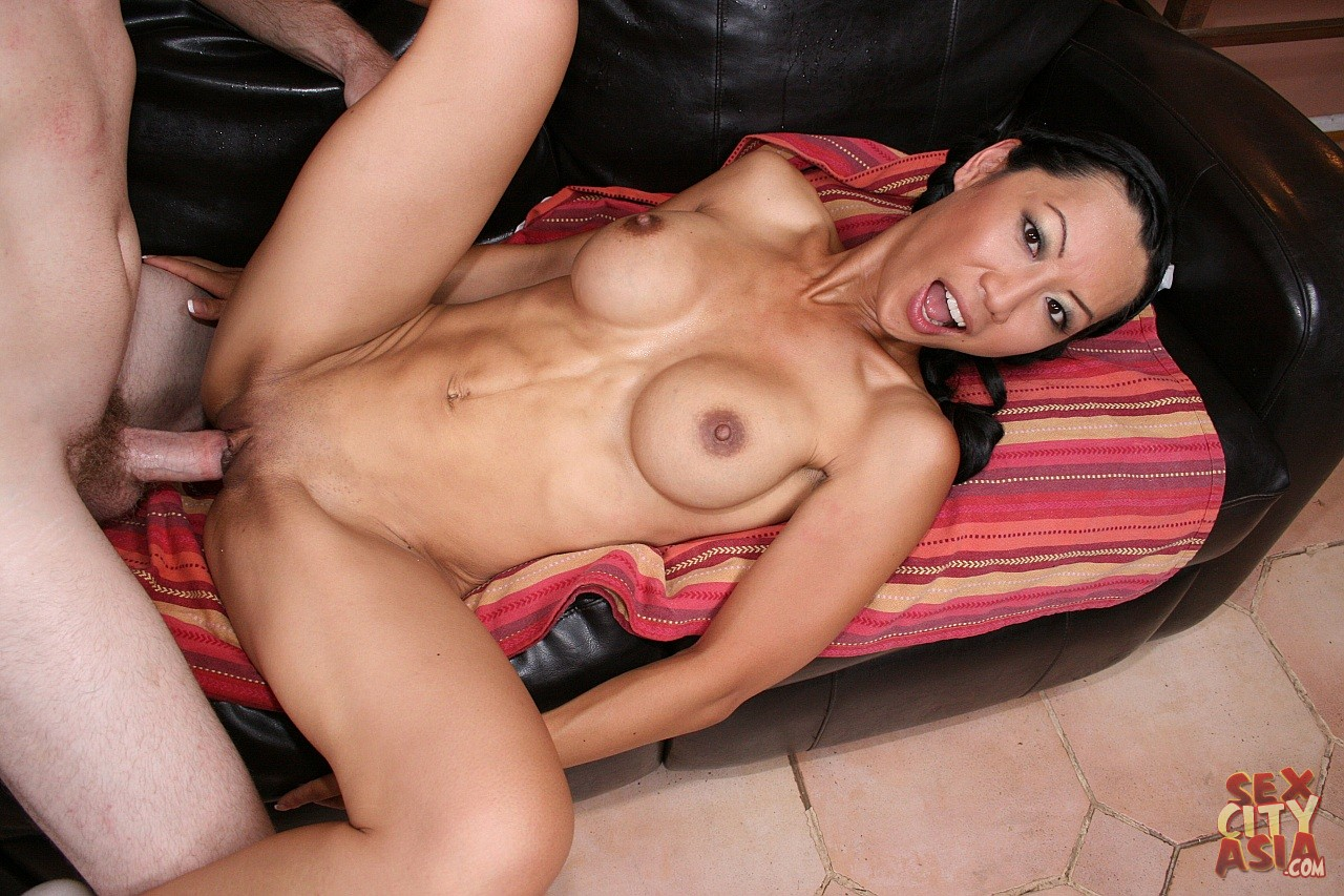 Tia Ling enjoys big hard cock in her tight pussy.