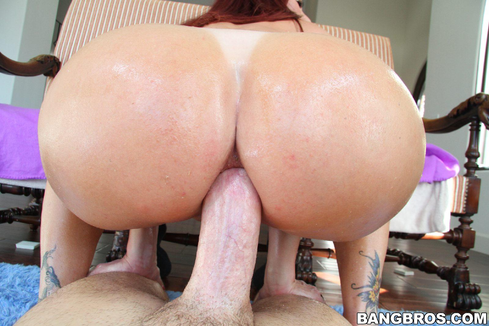 Naughty redhead Tiffany Mynx enjoys huge dick in her asshole.