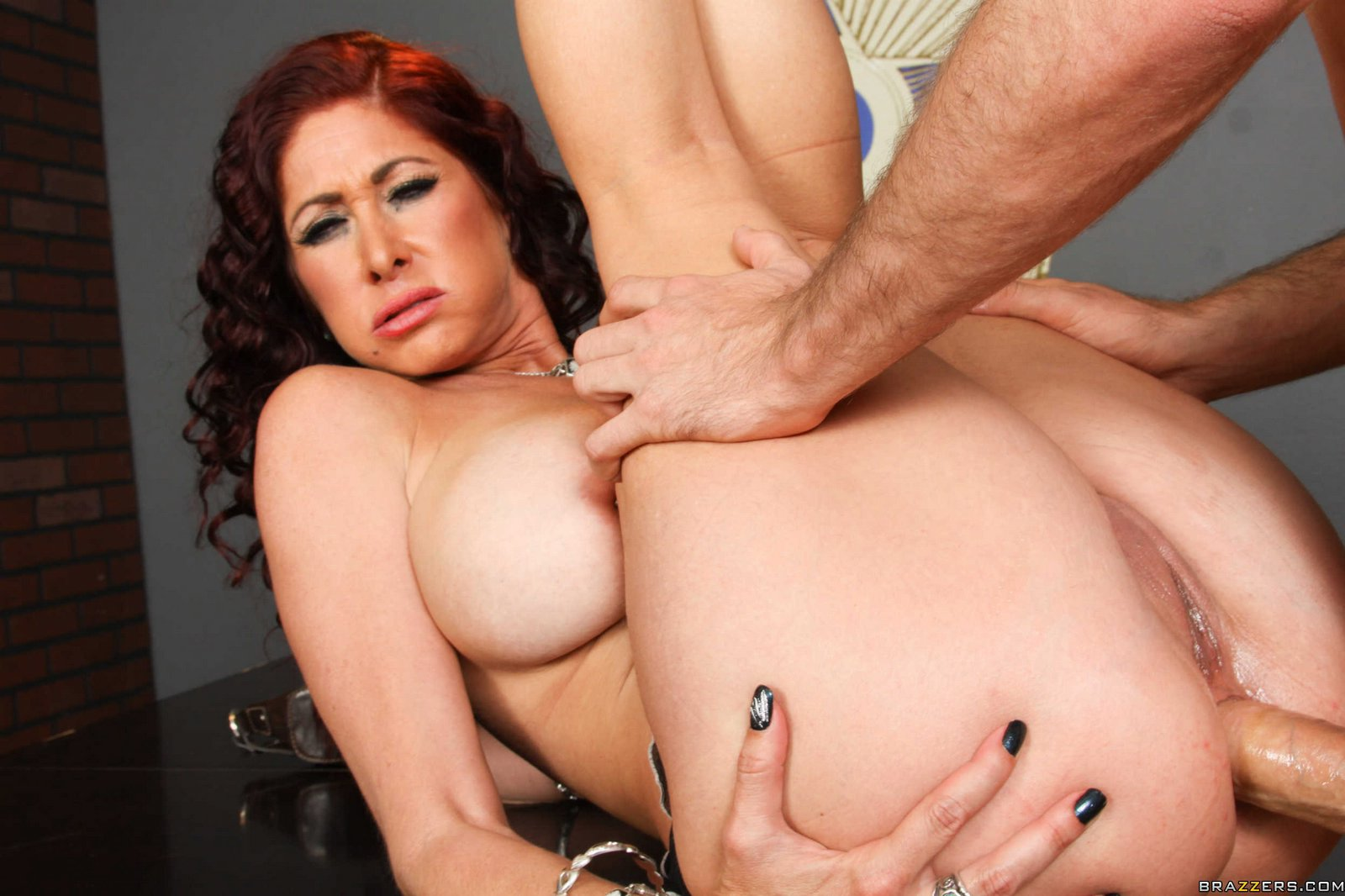 Naughty redhead Tiffany Mynx takes huge cock in her pussy and ass.