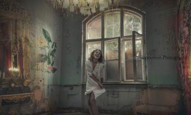 Indoor conceptual portrait photograph of girl