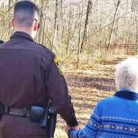 Cops pretend they are out on a walk to help take elderly woman with dementia home