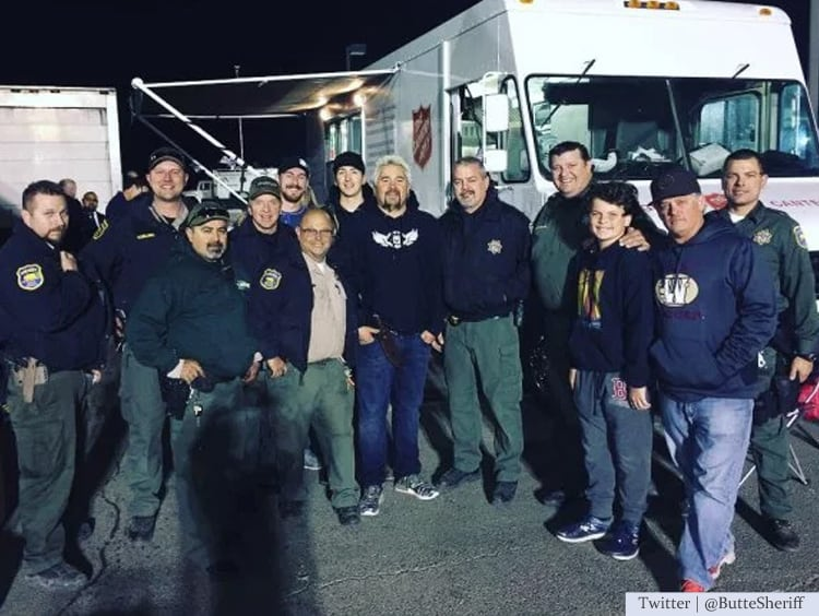 Guy Fieri cooks for firefighters.