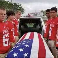 Teens flank Vietnam War veteran's coffin as they volunteer as pallbearers at his funeral