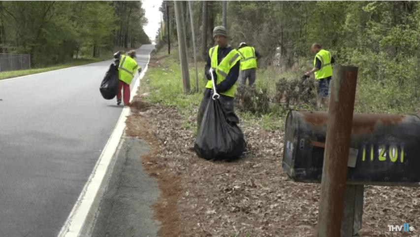 Homeless people picking up trash