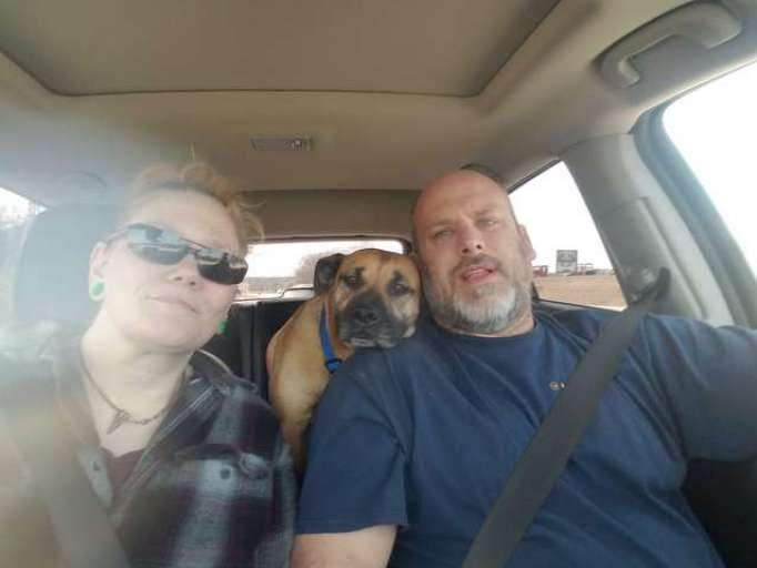 Angela, Bill, and River in the car